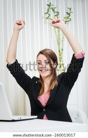 Beautiful happy business woman at office. Empty space. - stock photo