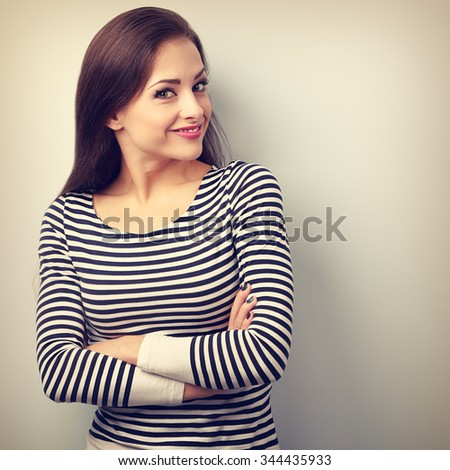 Beautiful happy casual woman with folded hand looking with smiling. Vintage closeup portrait - stock photo