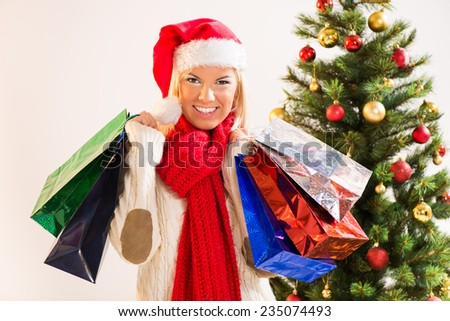 Beautiful happy Christmas girl with shopping bags. - stock photo