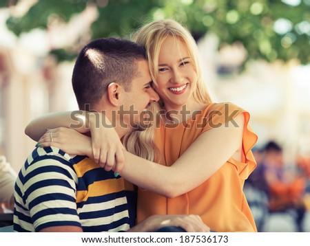 Beautiful happy couple embracing - stock photo