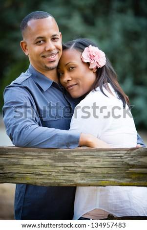 Beautiful happy couple hugging - stock photo