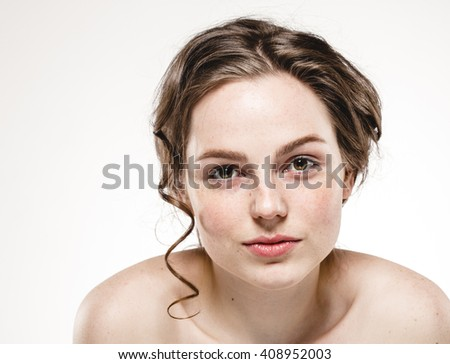 Beautiful happy curly woman freckles face portrait - stock photo