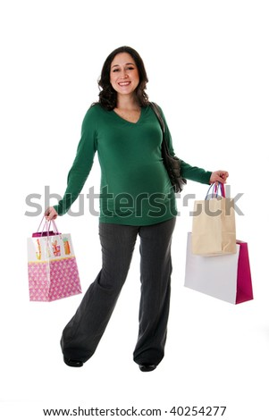 Beautiful happy exciting smiling Caucasian pregnant brunette woman holding shopping bags while standing, isolated - stock photo