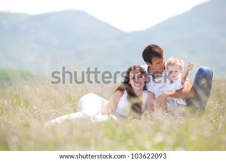 Beautiful happy family enjoying in the park - stock photo