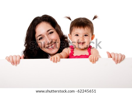 Beautiful happy family mother and teething baby daughter holding white board, isolated. - stock photo