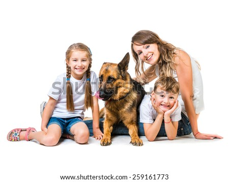 beautiful happy family:  mother with two children and their shepherd isolated on white - stock photo