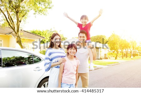 Beautiful happy family portrait  outside their  house - stock photo
