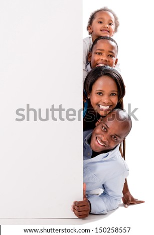 Beautiful happy family with a banner - isolated over white  - stock photo