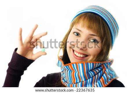 beautiful happy girl holding a tablet in her hand isolated against white background - stock photo