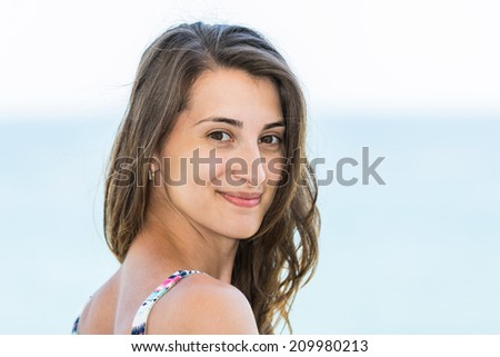Beautiful Happy Girl Portrait With Sea Background - stock photo