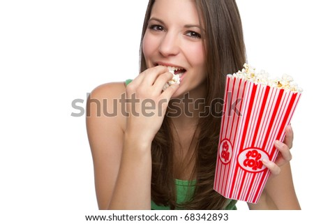 Beautiful happy person eating popcorn - stock photo