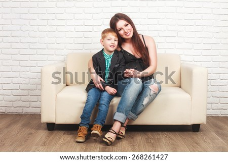 Beautiful, happy pregnant woman with her elder son - stock photo