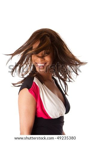 Beautiful happy smiling African American business woman in black with white and pink dress swirling and twirling her long hair while turning head, isolated. - stock photo