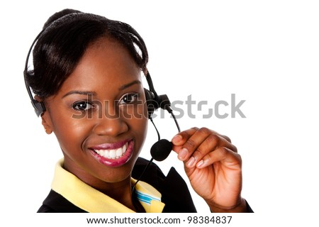 Beautiful happy smiling African business woman customer service representative operator, isolated. - stock photo
