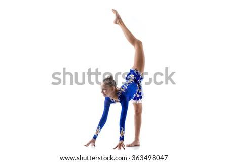 Beautiful happy smiling ballerina teenage girl wearing dancer blue leotard working out, dancing, posing, doing balance art gymnastics exercise, standing splits, studio, white background, isolated - stock photo