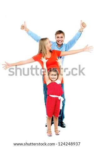 Beautiful happy smiling family of three people with young daughter, indoors - stock photo