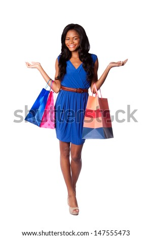 Beautiful happy smiling walking fashion consumer woman shopping with bags, wearing pumps, blue dress and belt, on white. - stock photo