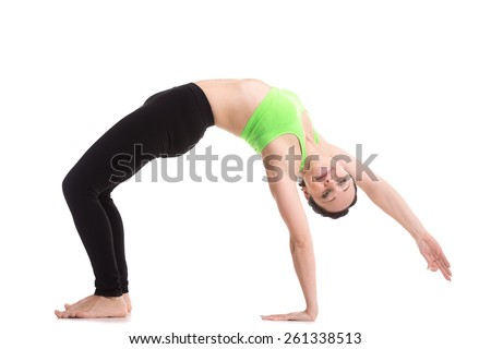 Beautiful happy sporty girl doing fitness workout, exercise bridge, asana Camatkarasana, Wild Thing, Dancing Dog yoga pose, training for strong back and shoulder muscles - stock photo