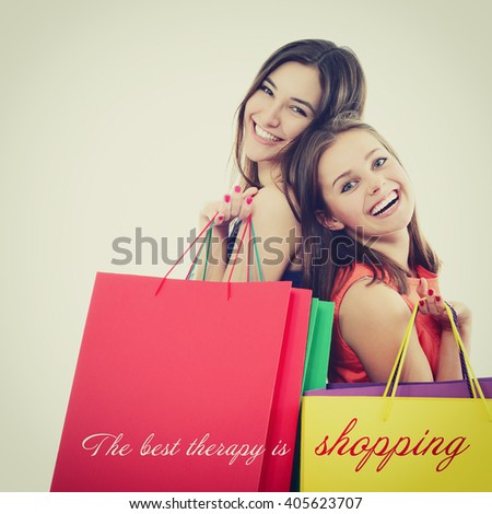 beautiful happy teen girls with colored shopping sale bags over white. The best therapy is shopping. - stock photo