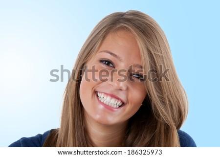 Beautiful happy teenager smiling, studio portrait  - stock photo