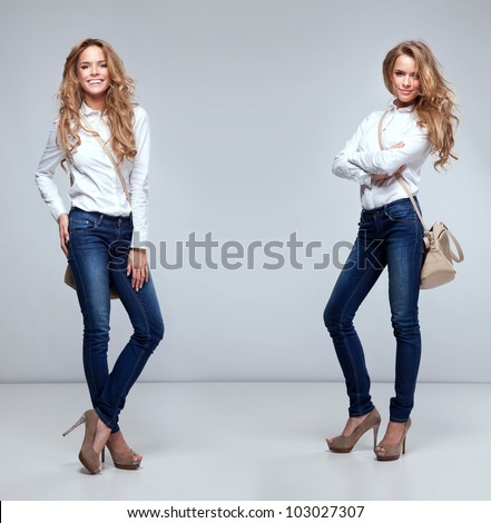 Beautiful happy twins on a grey background - stock photo