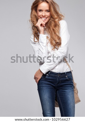 Beautiful happy woman holding a bag - stock photo