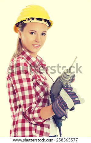 Beautiful happy woman holding drill. - stock photo