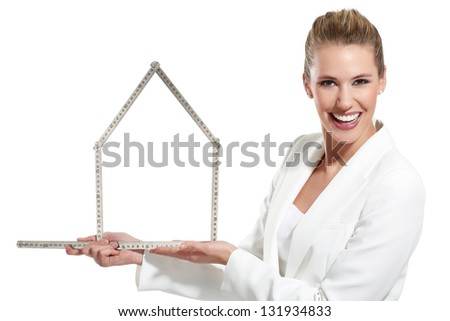 beautiful happy woman showing an house symbol  on white - stock photo