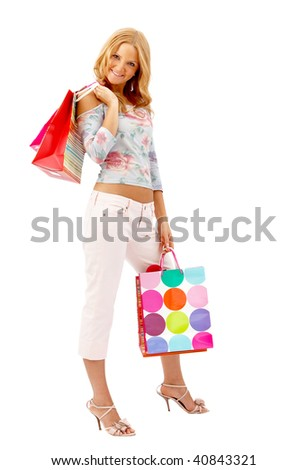 Beautiful happy woman with bags isolated on white - stock photo
