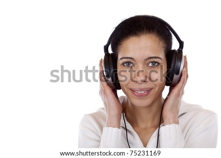 Beautiful, happy woman with headphones listens to mp3 music. Isolated on white background. - stock photo