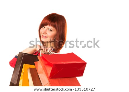 Beautiful happy woman with many shopping bags isolated on white. Shopping concept. - stock photo
