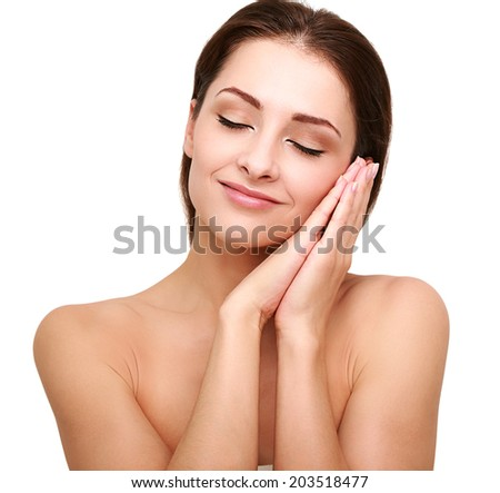 Beautiful happy woman with perfect clean skin and hands near the face. Closeup isolated model with closed eyes - stock photo