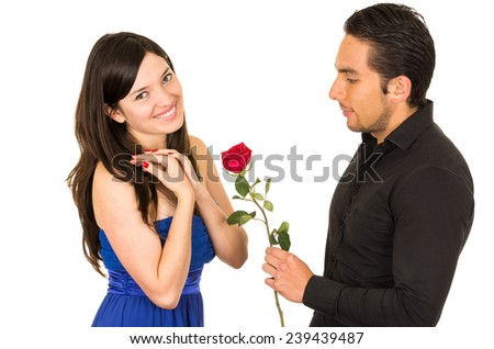 beautiful happy young girl accepting a red rose from boyfriend husband isolated on white - stock photo