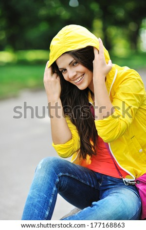 Beautiful happy young girl portrait - outdoors - stock photo