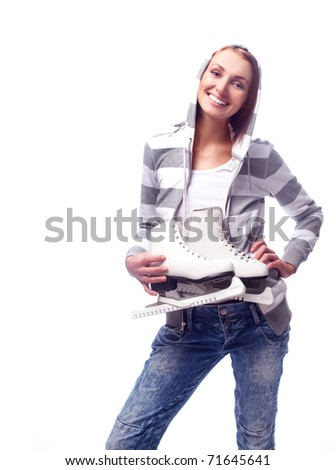 beautiful happy young woman going ice-skating - stock photo