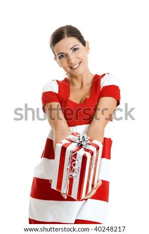 Beautiful happy young woman holding a christmas gift, isolated on white background - stock photo