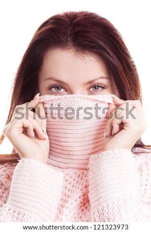 beautiful happy young woman wearing a high neck sweater, isolated against white background - stock photo