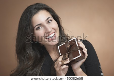 Beautiful happy young woman with birthday gift box - stock photo