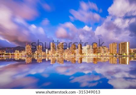Beautiful Hawaii skyline and reflection at twilight - stock photo