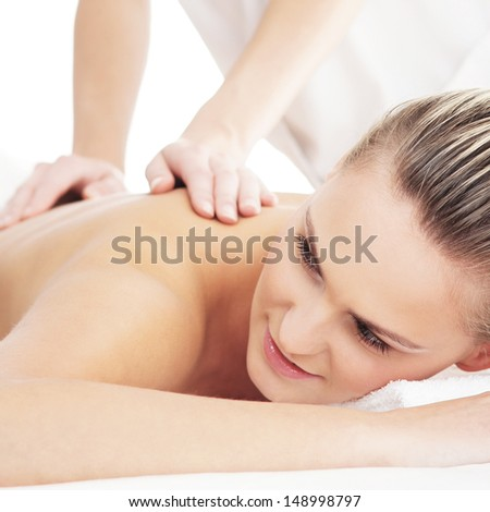 Beautiful, healthy and young woman is getting spa treatment isolated on white - stock photo