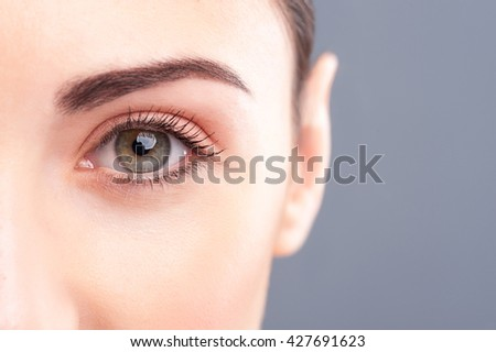 Beautiful healthy girl is staring at something - stock photo