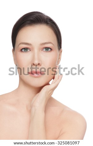 Beautiful healthy mature woman touching her face, over white background - stock photo