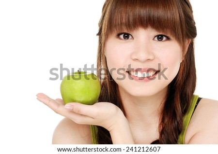 beautiful healthy serene girl with green apple - stock photo