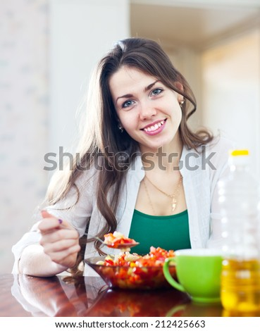 beautiful healthy woman eating veggie salad with spoon - stock photo