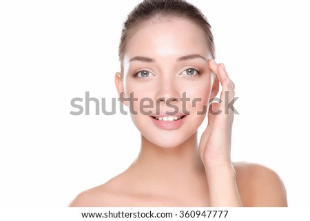Beautiful healthy woman touching her skin - stock photo