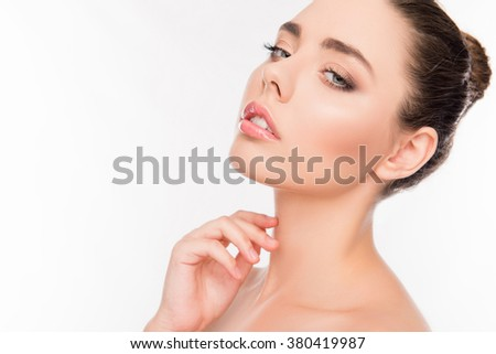 Beautiful healthy young woman om white background touching neck - stock photo