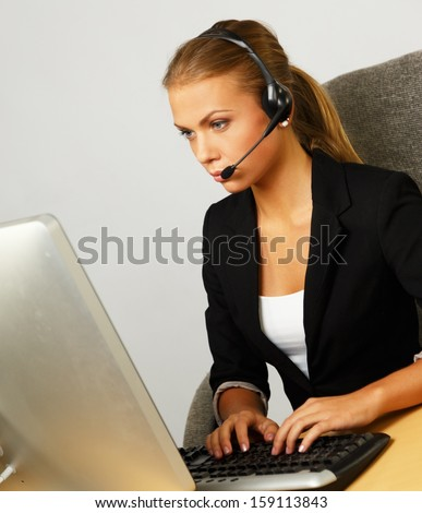 Beautiful help desk office support woman with headset - stock photo