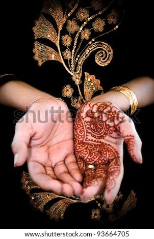 Beautiful henna tattoo in a bride's hand 03 - body art - stock photo