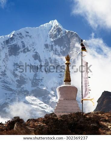 Beautiful himalayas with buddhist stupa and prayer flags near Thame village in Khumbu valley, Solukhumbu, Sagarmatha national park, Nepal - stock photo