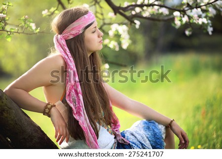Beautiful hippie woman enjoying spring . Harmony with nature - stock photo